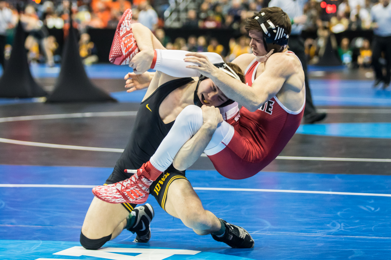 Iowa%E2%80%99s+125-pound+Spencer+Lee+wrestles+NC+State%E2%80%99s+Sean+Fausz+during+the+second+session+of+the+2019+NCAA+D1+Wrestling+Championships+at+PPG+Paints+Arena+in+Pittsburgh%2C+PA+on+Thursday%2C+March+21%2C+2019.+Lee+won+by+major+decision%2C+10-1.