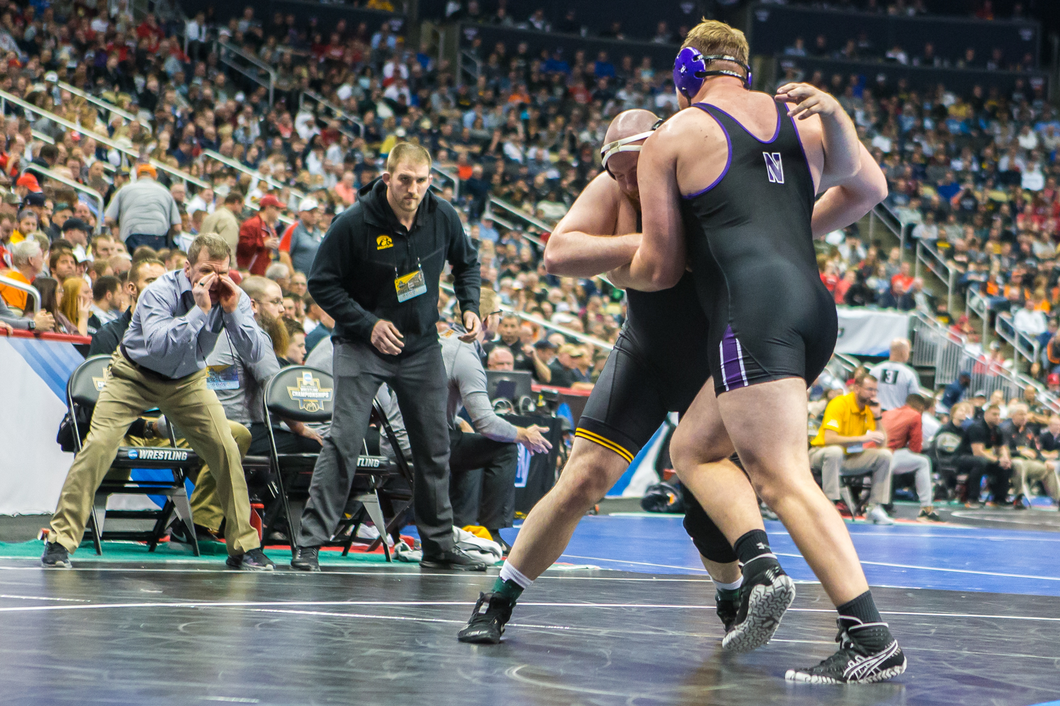 Iowa%E2%80%99s+285-pound+Sam+Stoll+wrestles+Northwestern%E2%80%99s+Conan+Jennings+during+the+second+session+of+the+2019+NCAA+D1+Wrestling+Championships+at+PPG+Paints+Arena+in+Pittsburgh%2C+PA+on+Thursday%2C+March+21%2C+2019.+Stoll+won+by+decision%2C+1-0.
