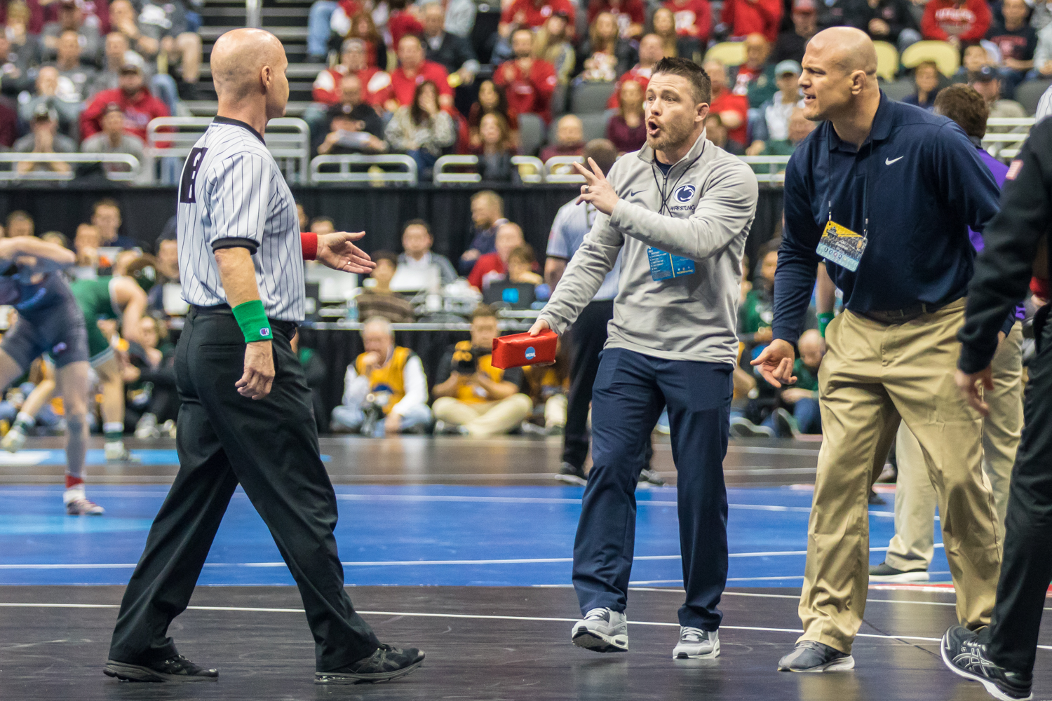 Penn+State+coaches+challenge+a+call+during++Roman+Bravo-Young%27s+bout+with+Iowa%27s+Austin+DeSanto+during+the+second+session+of+the+2019+NCAA+D1+Wrestling+Championships+at+PPG+Paints+Arena+in+Pittsburgh%2C+PA+on+Thursday%2C+March+21%2C+2019.+DeSanto+won+by+decision%2C+7-2.