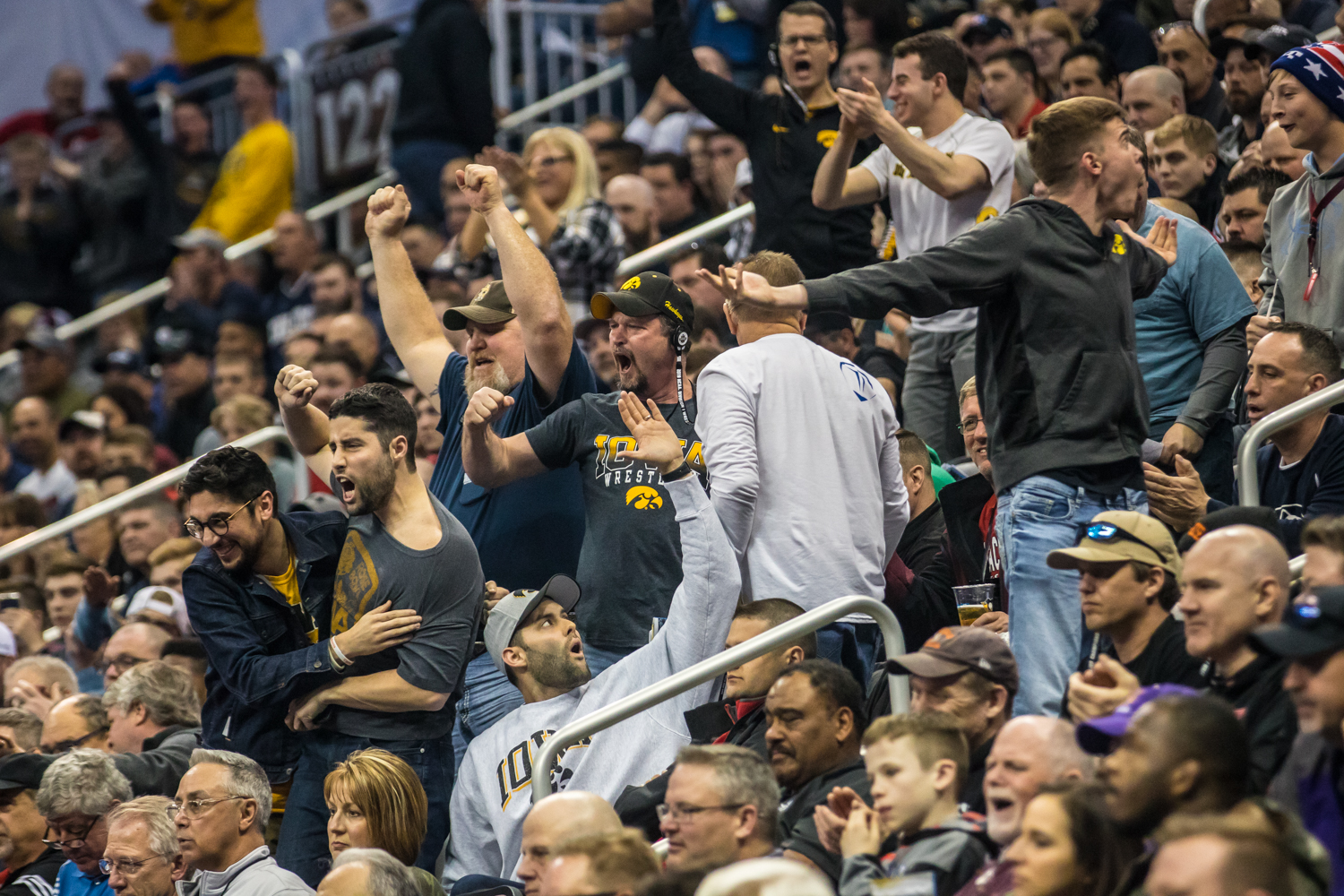 Iowa+fans+celebrate+a+call+in+Austin+DeSanto%27s+bout+with+Penn+State%27s+Roman+Bravo-Young+during+the+second+session+of+the+2019+NCAA+D1+Wrestling+Championships+at+PPG+Paints+Arena+in+Pittsburgh%2C+PA+on+Thursday%2C+March+21%2C+2019.+DeSanto+won+by+decision%2C+7-2.