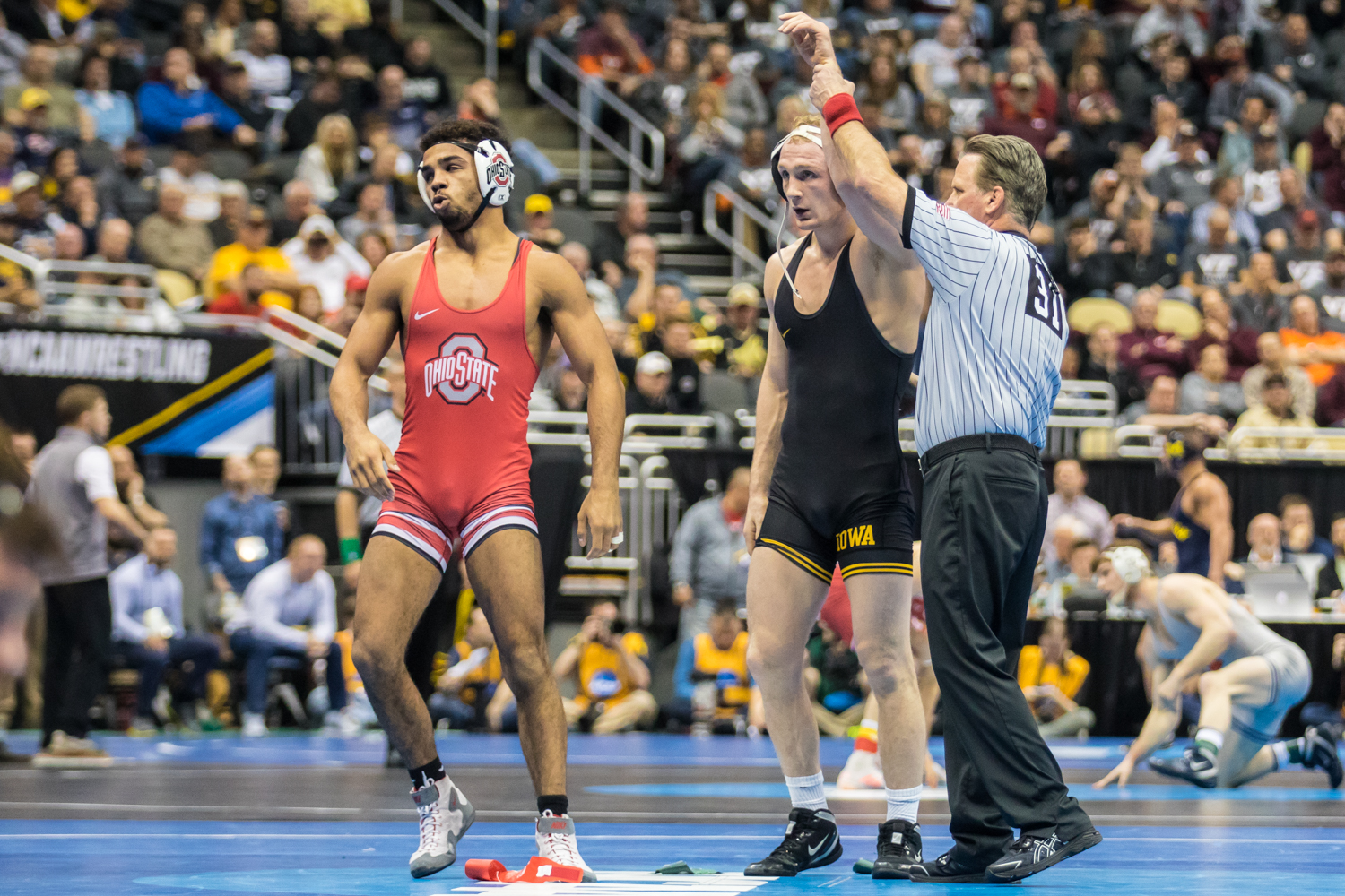 Iowa%E2%80%99s+157-pound+Kaleb+Young+defeats+Ohio+State%E2%80%99s+Ke-Shawn+Hayes+during+the+second+session+of+the+2019+NCAA+D1+Wrestling+Championships+at+PPG+Paints+Arena+in+Pittsburgh%2C+PA+on+Thursday%2C+March+21%2C+2019.+Young+won+by+major+decision%2C+14-2.