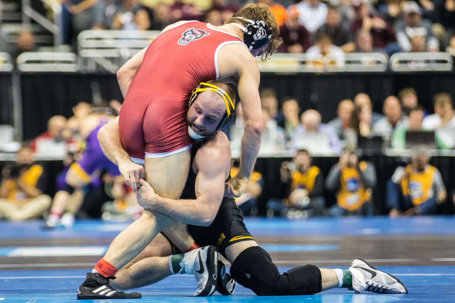 Iowa%E2%80%99s+165-pound+Alex+Marinelli+wrestles+NC+State%E2%80%99s+Thomas+Bullard+during+the+second+session+of+the+2019+NCAA+D1+Wrestling+Championships+at+PPG+Paints+Arena+in+Pittsburgh%2C+PA+on+Thursday%2C+March+21%2C+2019.+Marinelli+won+by+major+decision%2C+12-4.