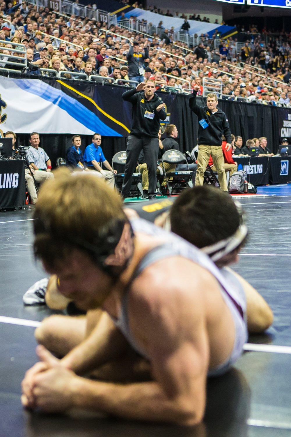 Iowa+coaches+celebrate+as+Iowa%E2%80%99s+149-pound+Pat+Lugo+wrestles+Virginia+Tech%E2%80%99s+Ryan+Blees+during+the+second+session+of+the+2019+NCAA+D1+Wrestling+Championships+at+PPG+Paints+Arena+in+Pittsburgh%2C+PA+on+Thursday%2C+March+21%2C+2019.+Lugo+won+in+the+second+overtime+period+by+sudden+victory%2C+4-2.