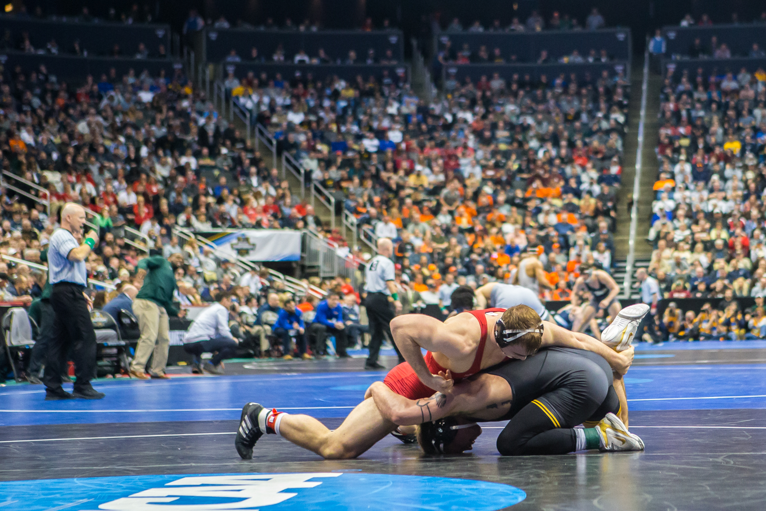 Iowa%E2%80%99s+184-pound+Cash+Wilcke+wrestles+Cornell%E2%80%99s+Maxwell+Dean+during+the+second+session+of+the+2019+NCAA+D1+Wrestling+Championships+at+PPG+Paints+Arena+in+Pittsburgh%2C+PA+on+Thursday%2C+March+21%2C+2019.+Dean+won+by+sudden+victory%2C+6-4.