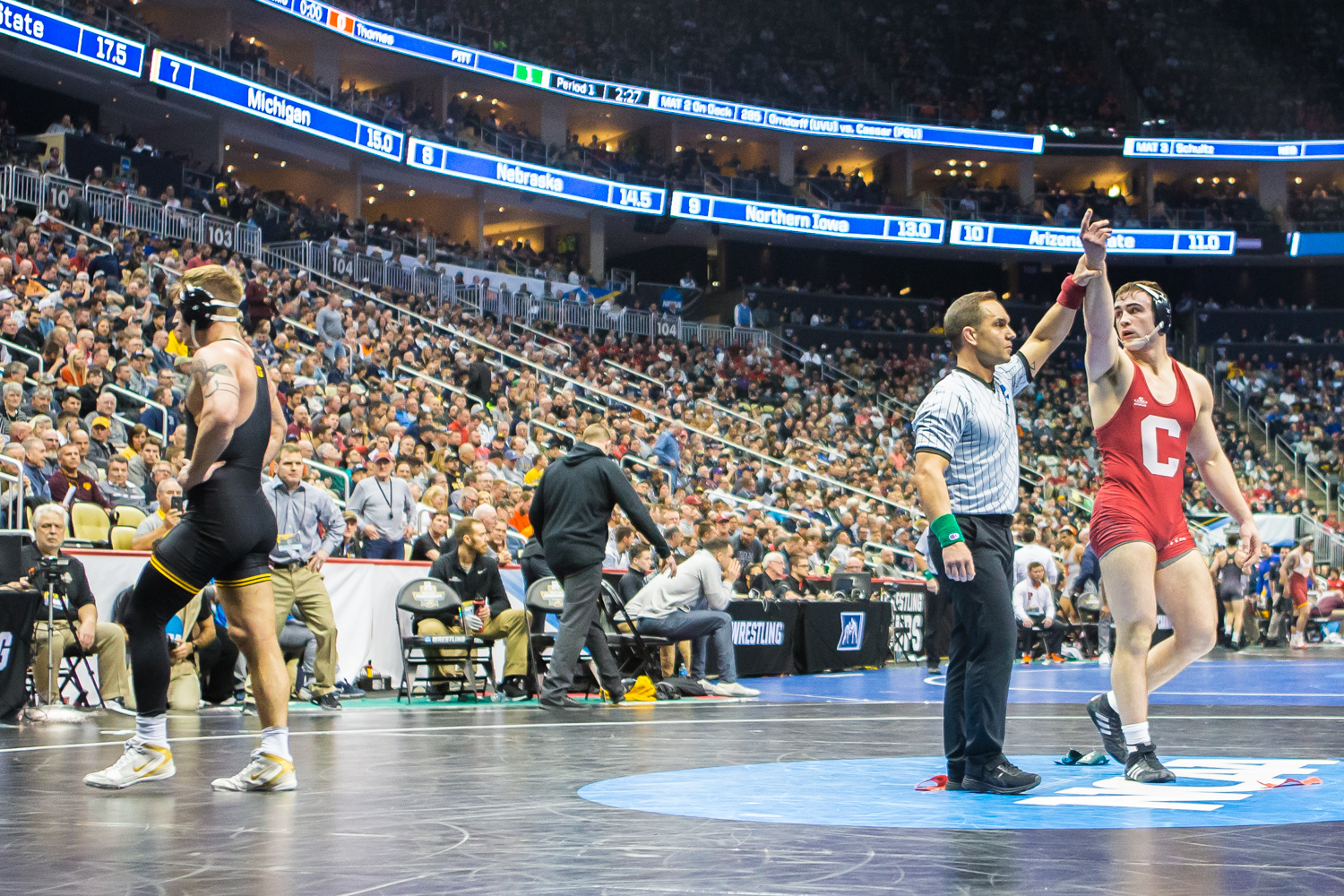 Iowa%E2%80%99s+184-pound+Cash+Wilcke+leaves+the+matt+after+his+bout+with+Cornell%E2%80%99s+Maxwell+Dean+during+the+second+session+of+the+2019+NCAA+D1+Wrestling+Championships+at+PPG+Paints+Arena+in+Pittsburgh%2C+PA+on+Thursday%2C+March+21%2C+2019.+Dean+won+by+sudden+victory%2C+6-4.+Wilcke%27s+loss++was+Iowa%27s+first+of+the+tournament.