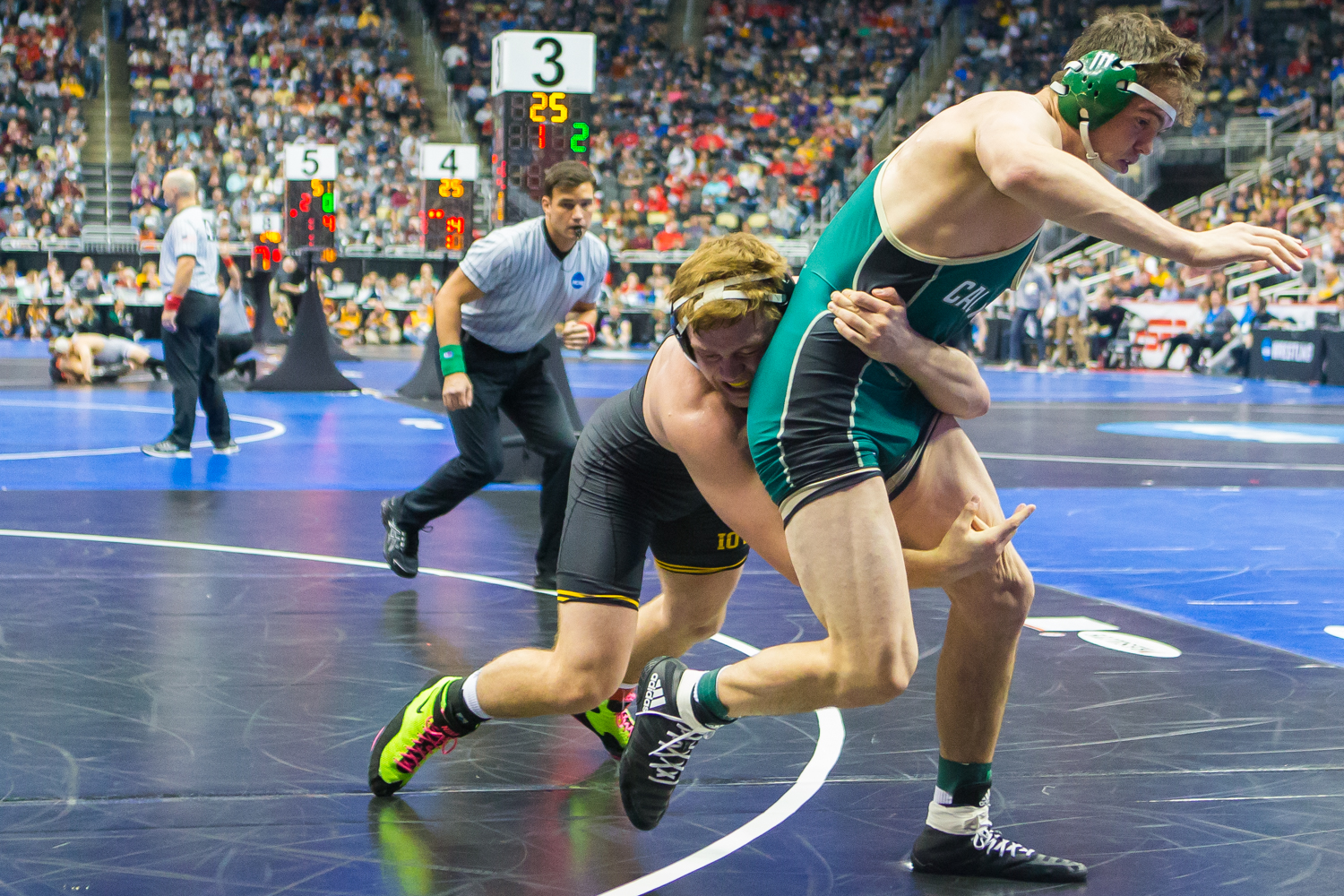 Iowa%E2%80%99s+197-pound+Jacob+Warner+wrestles+Cal+Poly%E2%80%99s+Thomas+Lane+during+the+second+session+of+the+2019+NCAA+D1+Wrestling+Championships+at+PPG+Paints+Arena+in+Pittsburgh%2C+PA+on+Thursday%2C+March+21%2C+2019.+Lane+won+by+sudden+victory%2C+4-2.
