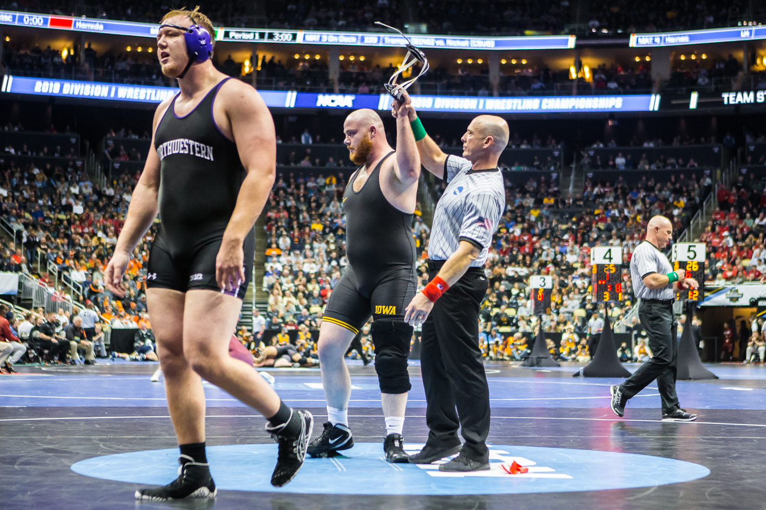 Iowa%E2%80%99s+285-pound+Sam+Stoll+defeats+Northwestern%E2%80%99s+Conan+Jennings+during+the+second+session+of+the+2019+NCAA+D1+Wrestling+Championships+at+PPG+Paints+Arena+in+Pittsburgh%2C+PA+on+Thursday%2C+March+21%2C+2019.+Stoll+won+by+decision%2C+1-0.