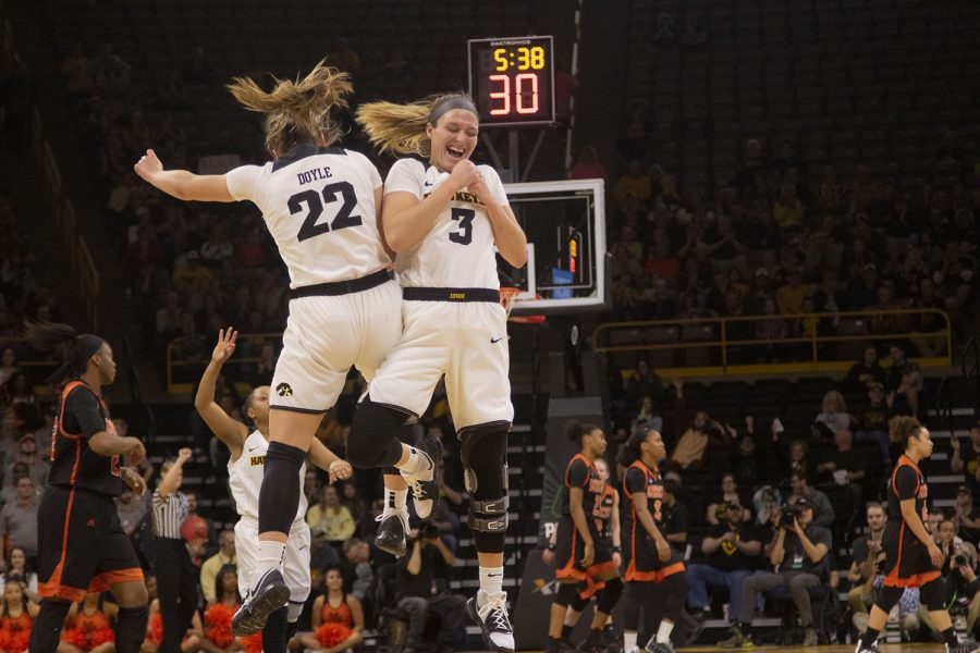 Iowa guard Makenzie Meyer (3) and Iowa guard Kathleen Doyle (22) celebrate during the Iowa/Mercer NCAA Tournament first round women's basketball game in Carver-Hawkeye Arena  on Friday, March 22, 2019. The Hawkeyes defeated the Bears, 66-61.