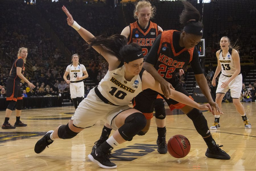 Iowa center Megan Gustafson and Mercer forward Lakaitlin Wright fight for control of the ball during the Iowa/Mercer NCAA Tournament first round women's basketball game in Carver-Hawkeye Arena  on Friday, March 22, 2019. (Lily Smith/The Daily Iowan)