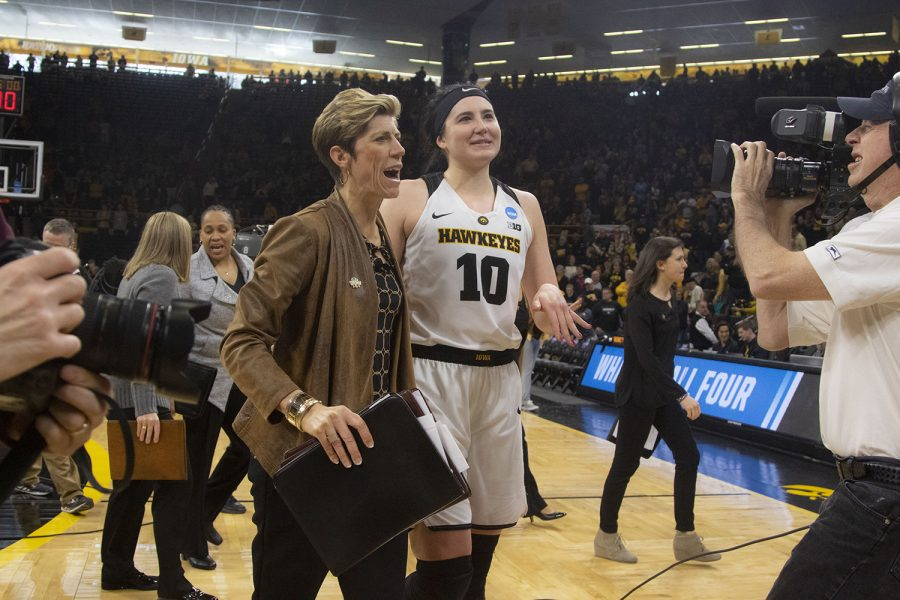 Iowa center Megan Gustafson speaks with Iowa associate head coach Jan Jensen after the Iowa/Mercer NCAA Tournament first round women's basketball game in Carver-Hawkeye Arena  on Friday, March 22, 2019. The Hawkeyes defeated the Bears, 66-61.