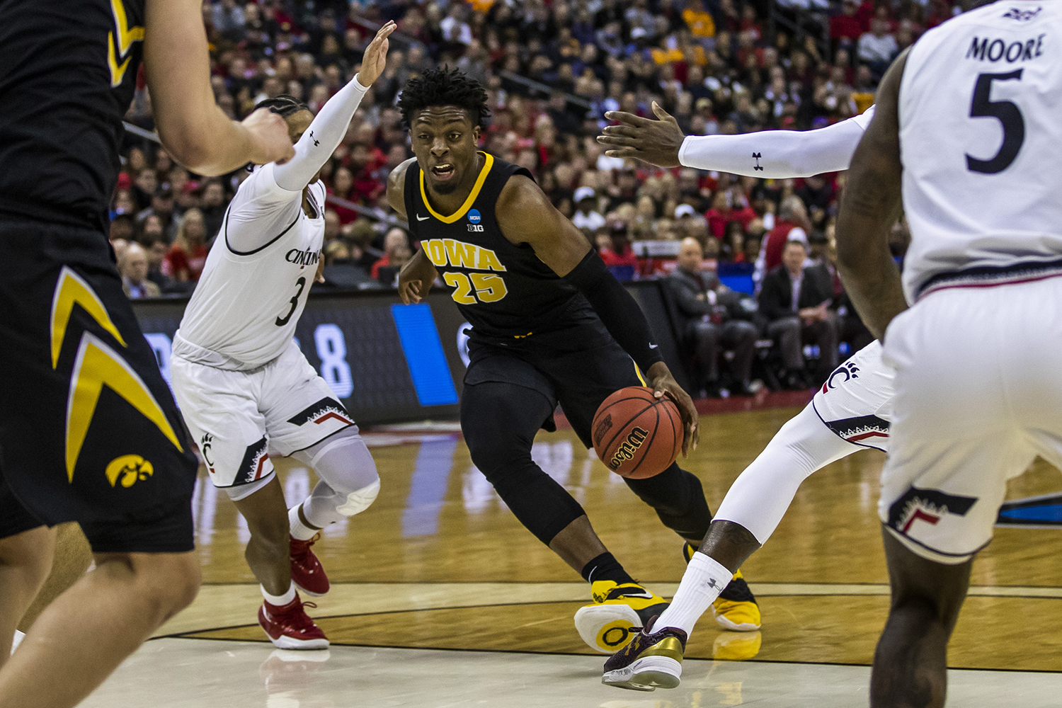 Iowa forward Tyler Cook drives the ball during the NCAA game against Cincinnati at Nationwide Arena on Friday, March 22, 2019. The Hawkeyes defeated the Bearcats 79-72.