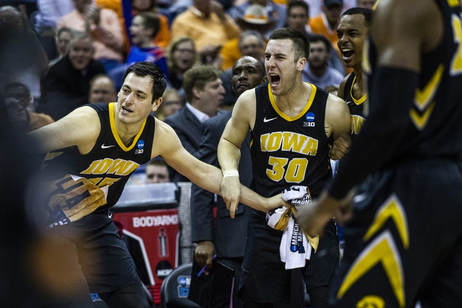 Iowa+players+cheer+during+the+NCAA+game+against+Cincinnati+at+Nationwide+Arena+on+Friday%2C+March+22%2C+2019.+The+Hawkeyes+defeated+the+Bearcats+79-72.