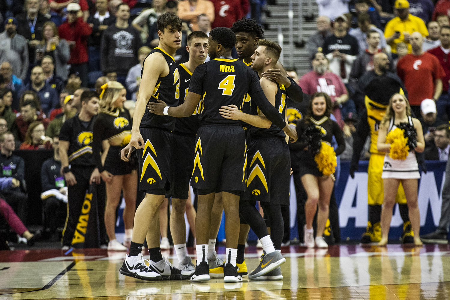 Iowa players come together before the NCAA game against Cincinnati at Nationwide Arena on Friday, March 22, 2019. The Hawkeyes defeated the Bearcats 79-72.