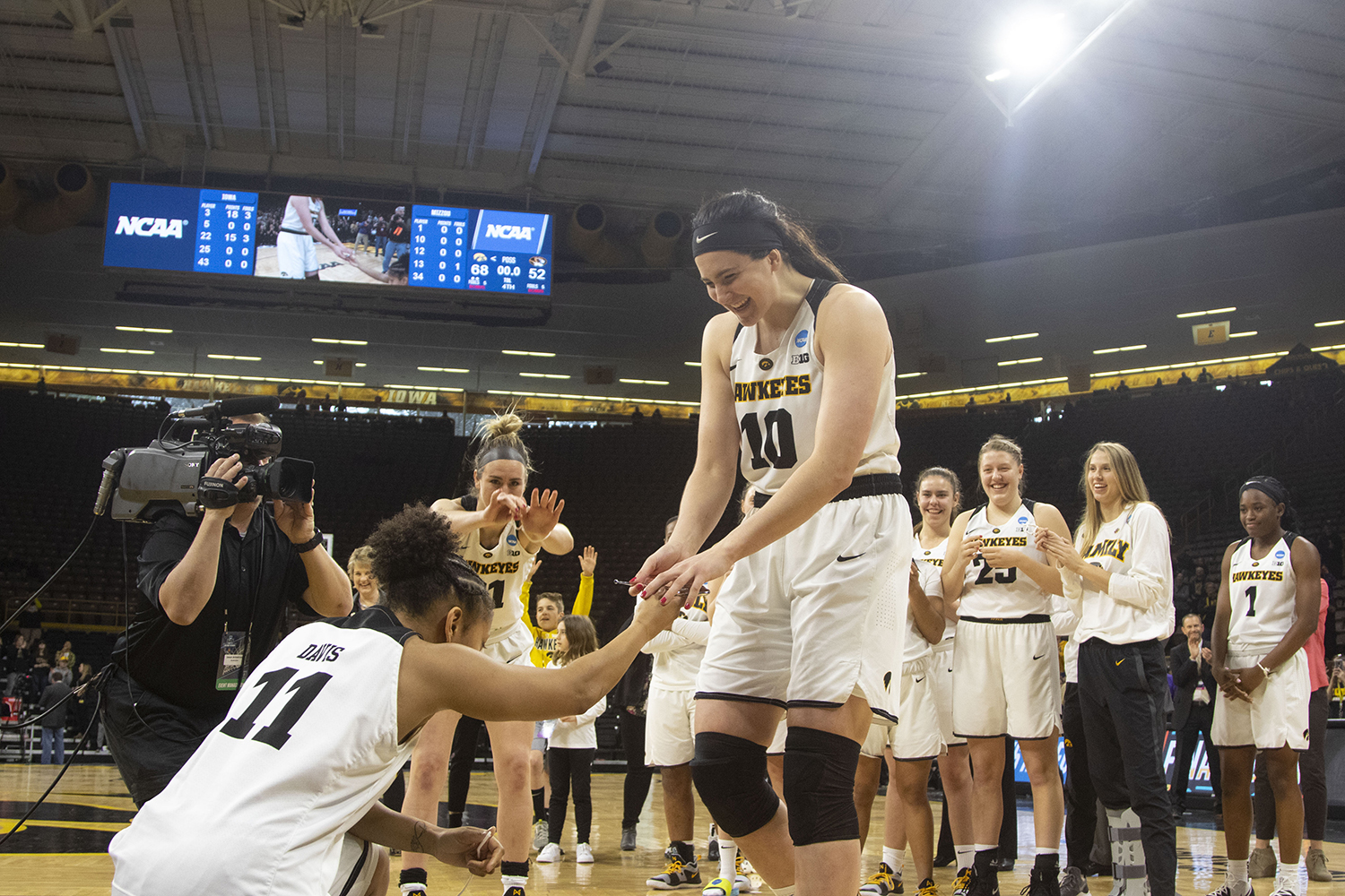 Iowa+center+Megan+Gustafson+%2810%29+is+presented+scissors+by+Iowa+guard+Tania+Davis+%2811%29+during+the+Iowa%2FMizzou+NCAA+Tournament+second+round+women%27s+basketball+game+in+Carver-Hawkeye+Arena++on+Sunday%2C+March+24%2C+2019.+The+Hawkeyes+defeated+the+Tigers%2C+68-52.+