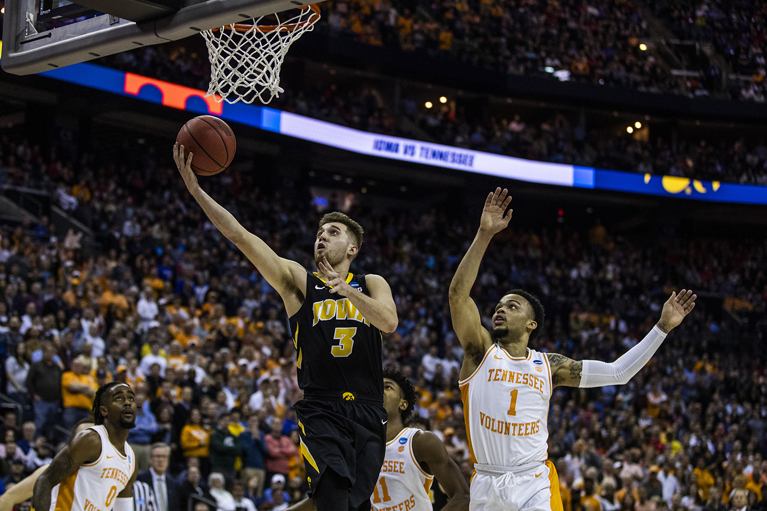 Iowa guard Jordan Bohannon shoots the ball during the NCAA game against Tennessee at Nationwide Arena on Sunday, March 24, 2019. The Volunteers defeated the Hawkeyes 83-77 in overtime.