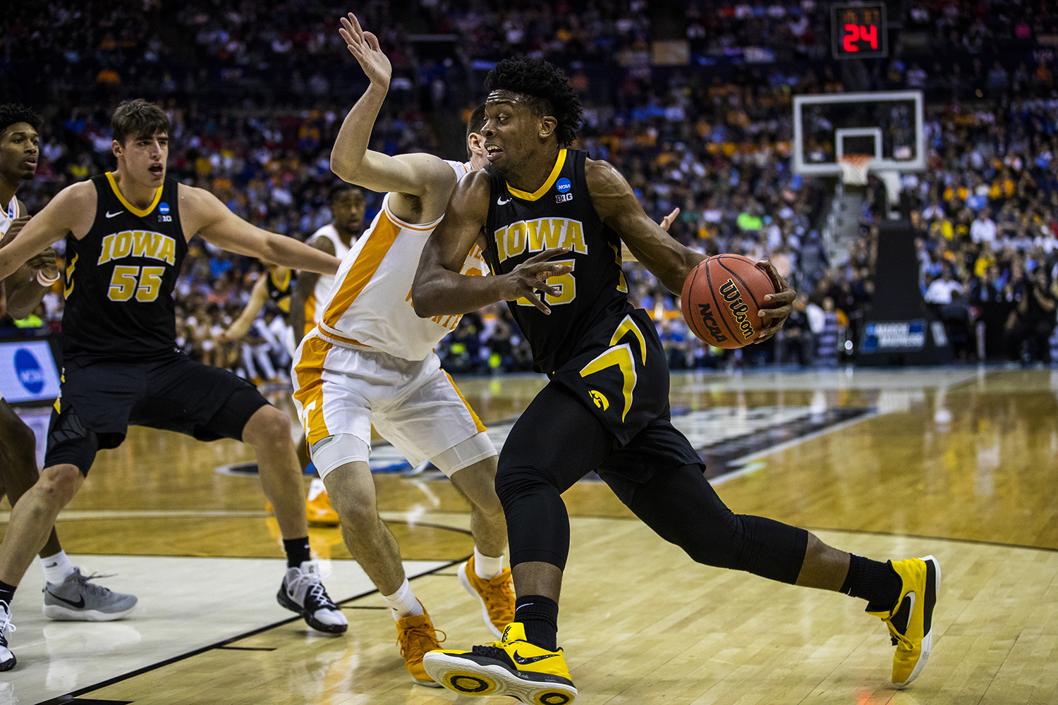 Iowa forward Tyler Cook drives past Tennessee forward John Fulkerson during the NCAA game against Tennessee at Nationwide Arena on Sunday, March 24, 2019. The Volunteers defeated the Hawkeyes 83-77 in overtime.