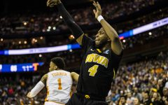 Iowa guard Isaiah Moss shoots a three-pointer during the NCAA game against Tennessee at Nationwide Arena on Sunday, March 24, 2019. The Volunteers defeated the Hawkeyes 83-77 in overtime.