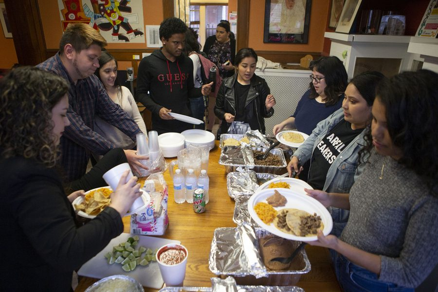 The ALMA executive board serves food during the Latinas in the Community Dinner in the LNACC on Wednesday, March 27, 2019. The event was hosted by the Association of Latinos Moving Ahead. (ALMA)