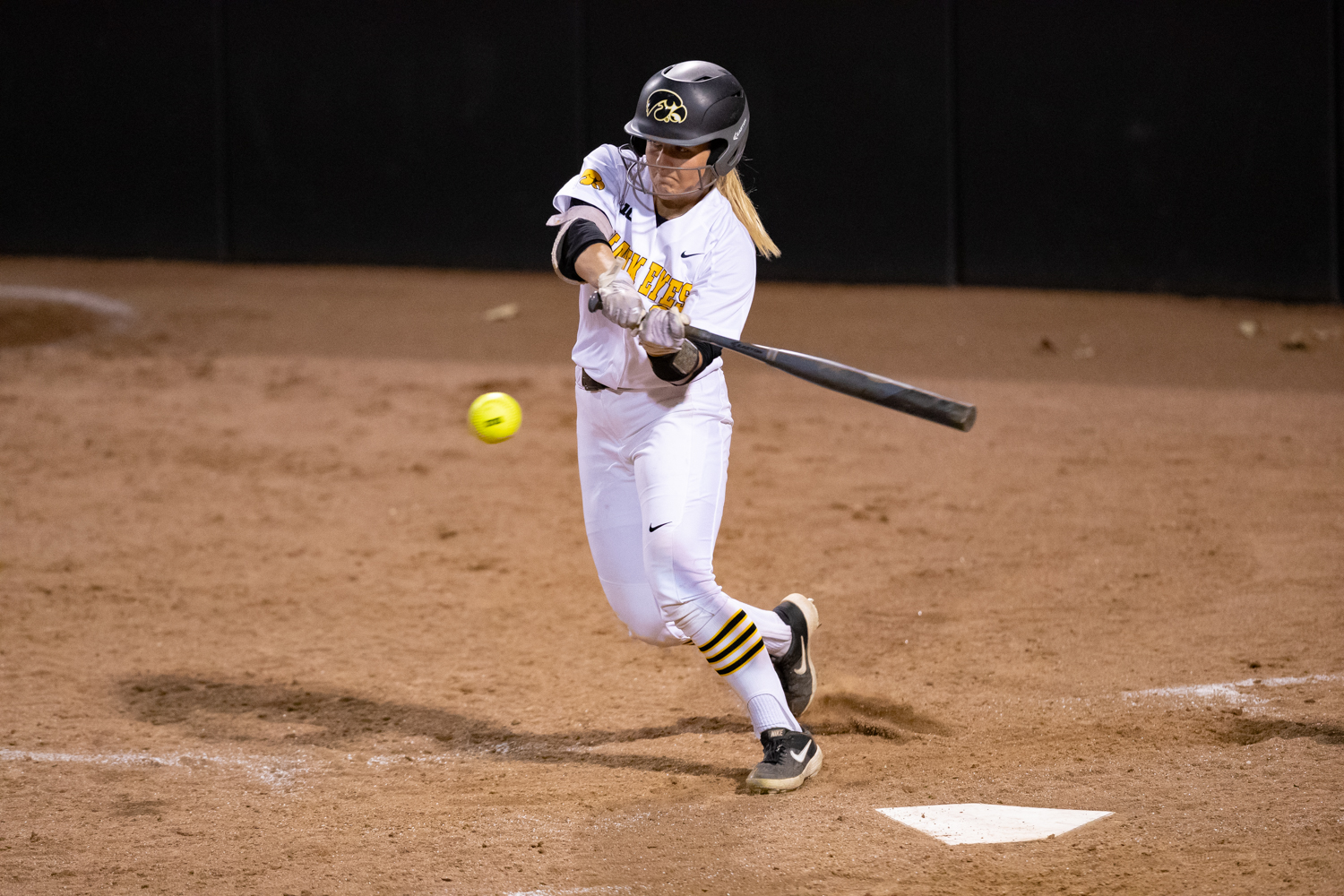 Iowa's Havyn Monteer winds up to connect on a pitch during a softball game against Western Illinois on Wednesday, Mar. 27, 2019. The Fighting Leathernecks defeated the Hawkeyes 10-1.
