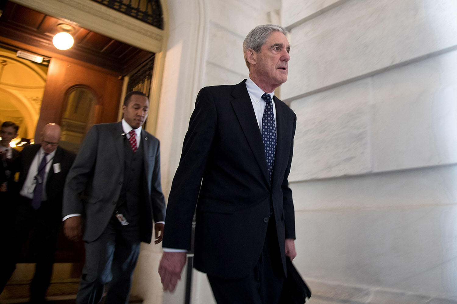 Former FBI Director Robert Mueller, front, the special counsel probing Russian interference in the 2016 U.S. election, leaves the Capitol building after meeting with the Senate Judiciary Committee on Capitol Hill on June 21, 2017, in Washington, D.C. (Ting Shen/Xinhua/Zuma Press/TNS)