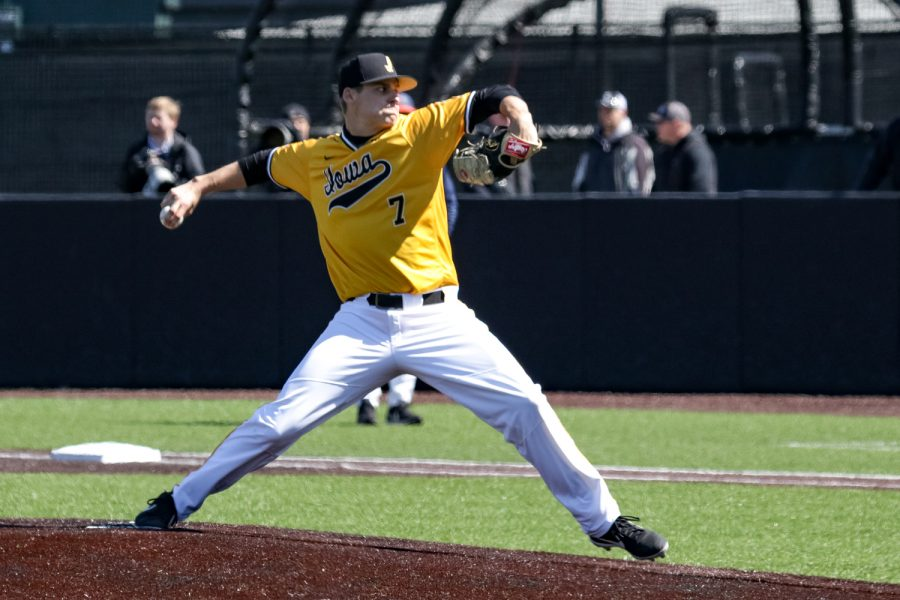 Iowa's Grant Judkins winds up to pitch during a baseball game against the University of Illinois on Sunday, Mar. 31, 2019. The Hawkeyes defeated the Illini 3-1.