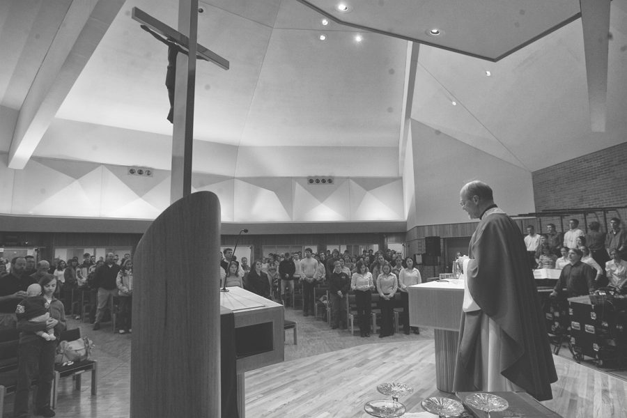 Father+Edward+Fitzpatrick+conducts+an+evening+mass+on+Sunday+at+the+Newman+Catholic+Student+Center.+A+UI+study+recently+found+a+correlation+between+attending+religious+services+and+a+longer+life+expectancy.