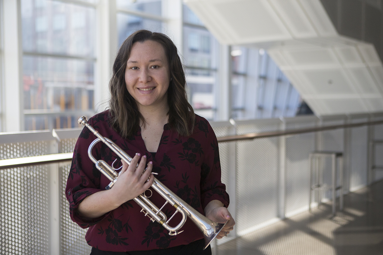 Toni LeFebvre poses for a portrait with her trumpet in the Voxman Music Building on Wednesday, March 6, 2019. (Jenna Galligan /The Daily Iowan)