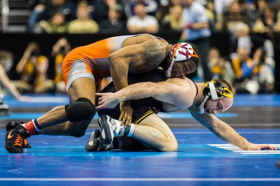 Iowa's 165-pound Alex Marinelli wrestles Virginia Tech's Mekhi Lewis during the third session of the 2019 NCAA D1 Wrestling Championships at PPG Paints Arena in Pittsburgh, PA on Friday, March 22, 2019. Lewis won by decision, 3-1.
