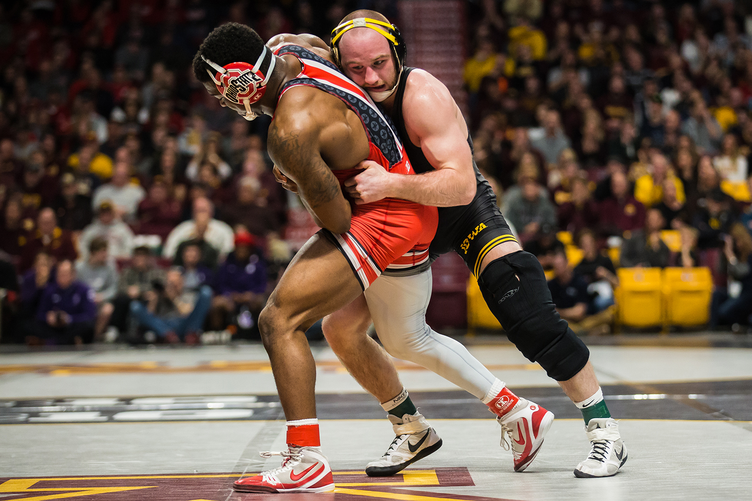 Iowa's 165-lb Alex Marinelli wrestle's Ohio State's Te'Shan Campbell during the first session of the 2019 Big Ten Wrestling Championships in Minneapolis, MN on Saturday, March 9, 2019. Marinelli won by decision, 6-3. (Shivansh Ahuja/The Daily Iowan)