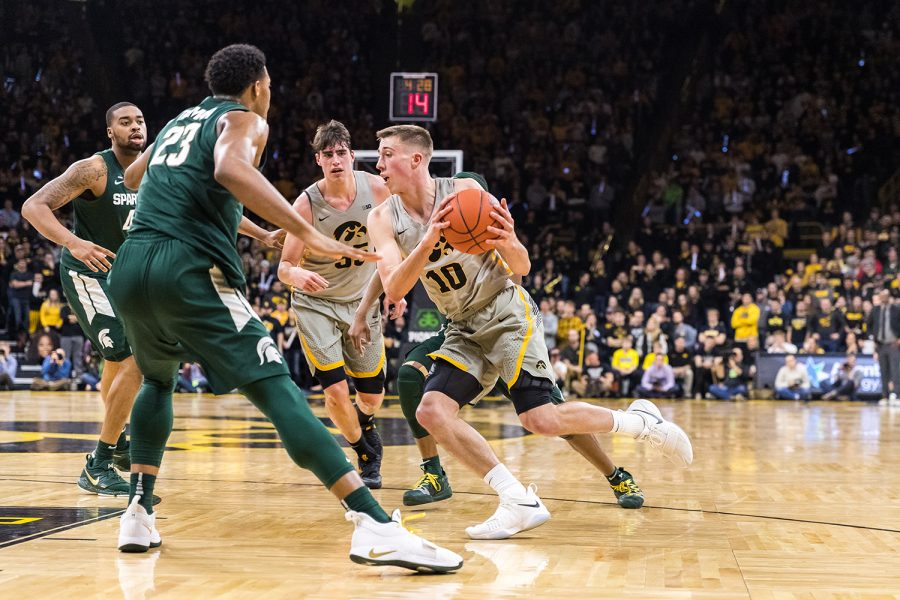 Iowa+guard+Joe+Wieskamp+%2310+drives+into+traffic+during+a+basketball+game+against+Michigan+State+on+Thursday%2C+Jan.+24%2C+2019.+The+Spartans+defeated+the+Hawkeyes+82-67.+