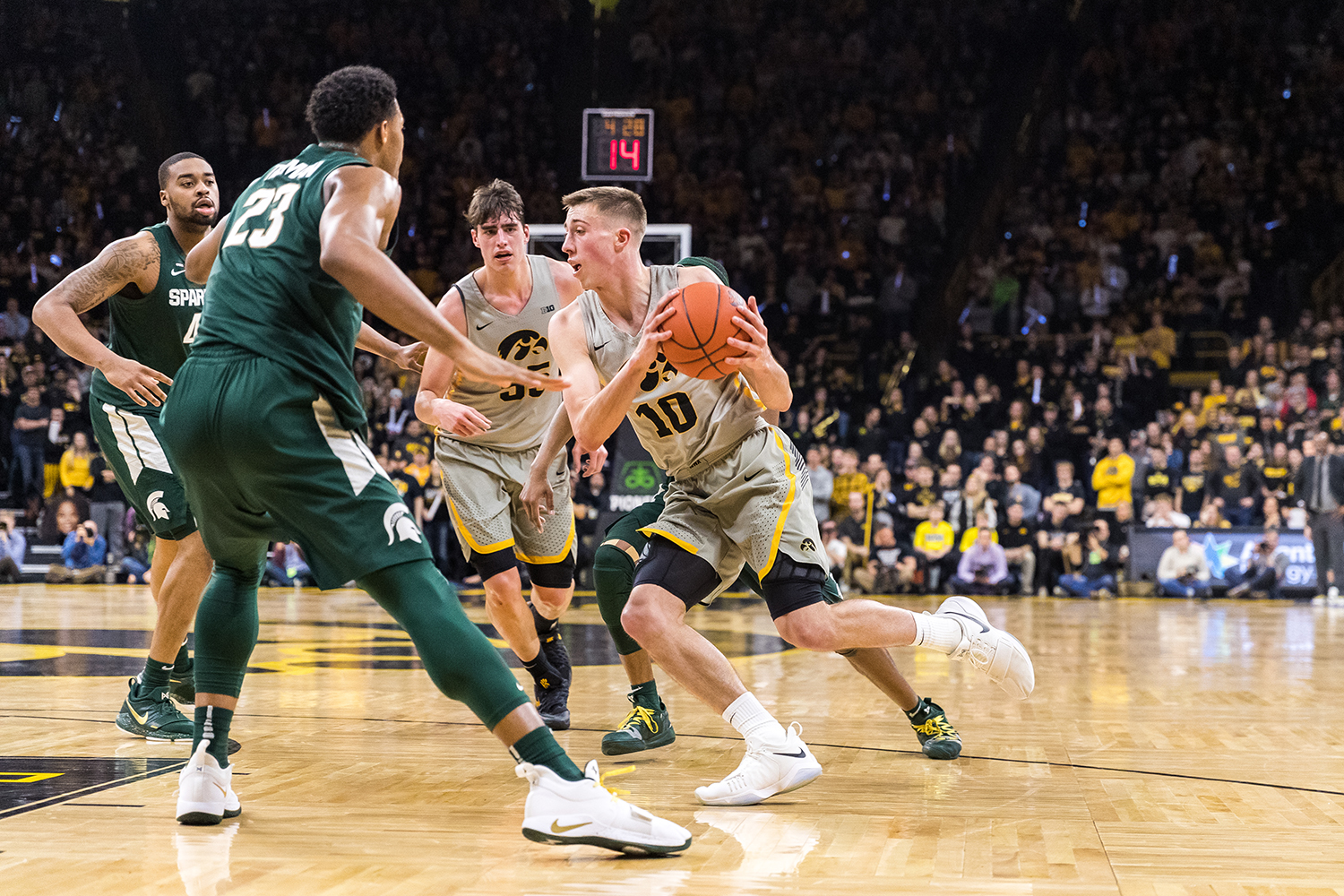 Iowa guard Joe Wieskamp #10 drives into traffic during a basketball game against Michigan State on Thursday, Jan. 24, 2019. The Spartans defeated the Hawkeyes 82-67.
