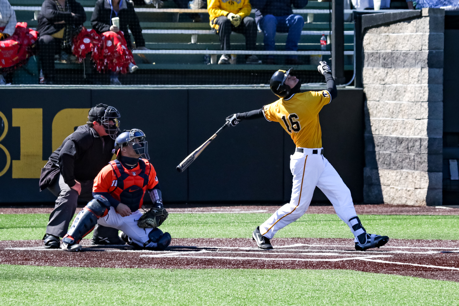 Iowa's Tanner Wetrich pops the ball up during a baseball game against the University of Illinois on Sunday, Mar. 31, 2019. The Hawkeyes defeated the Illini 3-1.