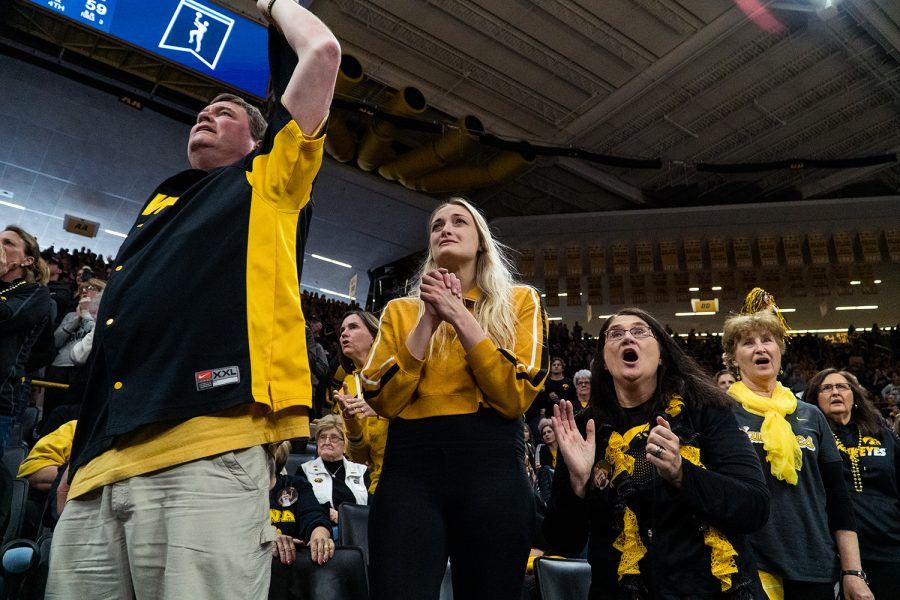 Megan Gustafson's (10) family cheers her on during the Iowa/Mercer NCAA Tournament first round women's basketball game in Carver-Hawkeye Arena in Iowa City, Iowa on Friday, March 22, 2019. The Hawkeyes beat the Bears 66-61.