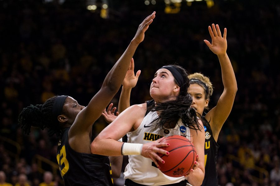 Iowa center Megan Gustafson (10) attempts a shot during the Iowa/Missouri NCAA Tournament second round women's basketball game in Carver-Hawkeye Arena in Iowa City, Iowa on Sunday, March 24, 2019. The Hawkeyes defeated the Tigers 68-52.