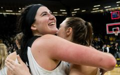 Iowa center Megan Gustafson (10) hugs Iowa forward Amanda Ollinger after the Iowa/Missouri NCAA Tournament second round women's basketball game in Carver-Hawkeye Arena in Iowa City, Iowa on Sunday, March 24, 2019. The Hawkeyes defeated the Tigers 68-52.