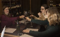 Graduate women develop emotional support group over a glass of wine