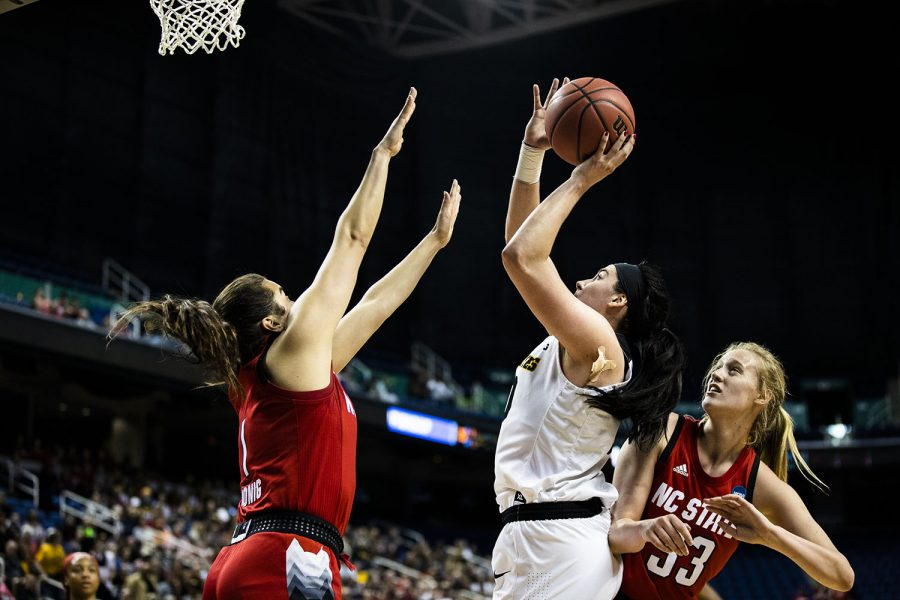Iowa center Megan Gustafson shoots the ball during the NCAA Sweet Sixteen game against NC State at the Greensboro Coliseum Complex on Saturday, March 30, 2019. The Hawkeyes lead the Wolfpack 37-24 at half.