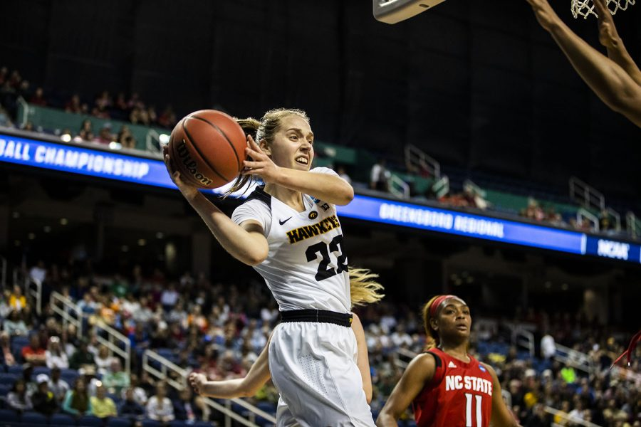 Iowa guard Kathleen Doyle looks to pass the ball during the NCAA Sweet Sixteen game against NC State at the Greensboro Coliseum Complex on Saturday, March 30, 2019. The Hawkeyes lead the Wolfpack 37-24 at half.