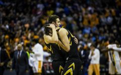 Iowa forward Nicholas Baer comforts Luka Garza after the loss against Tennessee in the NCAA tournament at Nationwide Arena on Sunday, March 24, 2019. The Volunteers defeated the Hawkeyes 83-77.