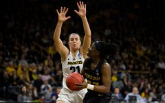 Iowa forward Hannah Stewart (21) attempts to block a shot during the Iowa/Missouri NCAA Tournament second round women's basketball game in Carver-Hawkeye Arena in Iowa City, Iowa on Sunday, March 24, 2019. The Hawkeyes defeated the Tigers 68-52.