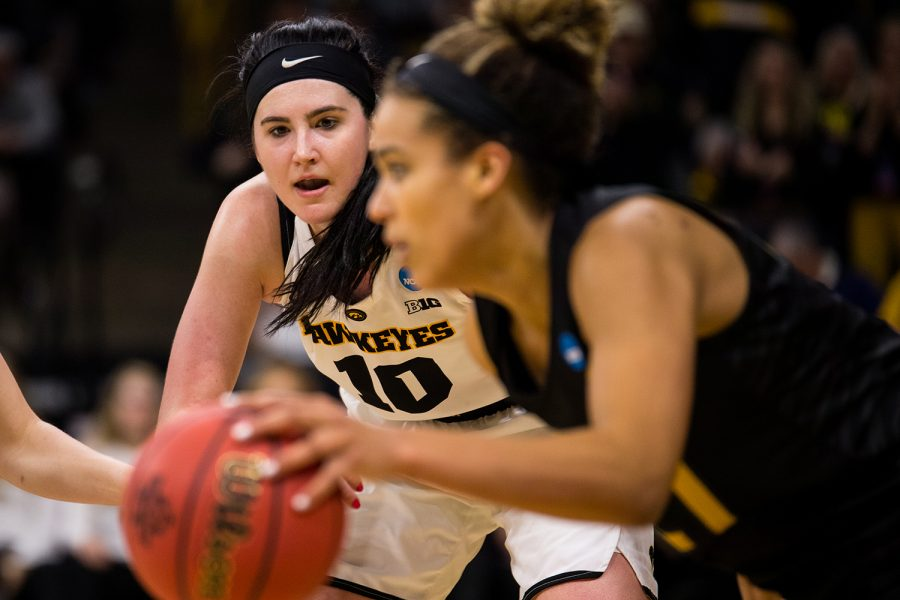 Iowa center Megan Gustafson (10) looks at the ball during the Iowa/Missouri NCAA Tournament second round women's basketball game in Carver-Hawkeye Arena in Iowa City, Iowa on Sunday, March 24, 2019. The Hawkeyes defeated the Tigers 68-52.