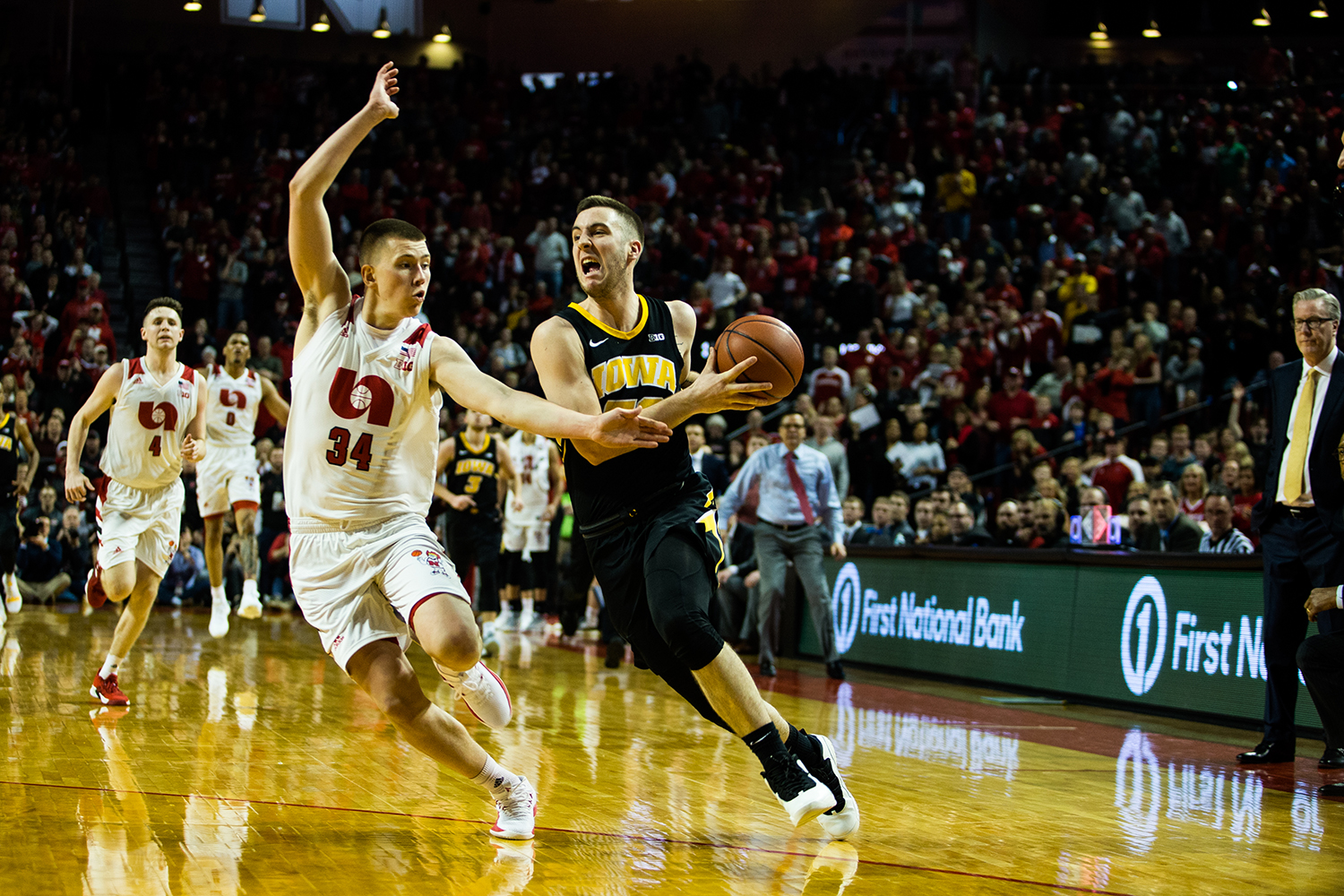 Iowa Guard Conner McCaffery #30 dribbles down the court during a mens basketball game between the Iowa Hawkeyes and the Nebraska Huskers at Pinnacle Bank Arena on Sunday, March 10, 2019. The Hawkeyes fell in overtime to the Huskers, 93-91.