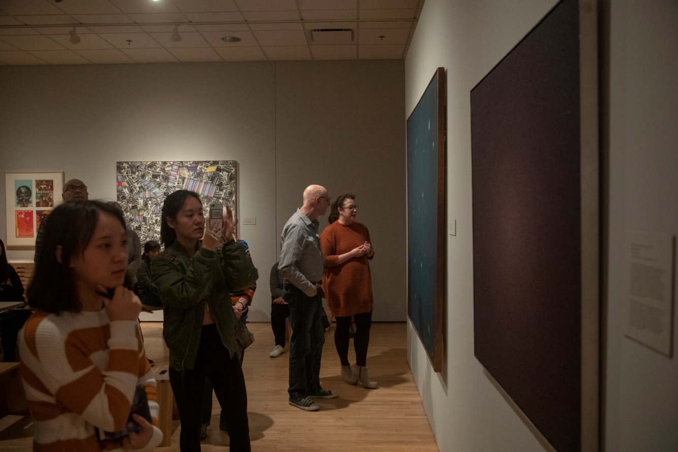 Attendees observe artwork during a Pointillism workshop at the Stanley Art Museum on Saturday March 9. The event was a collaboration between the art and theater department.