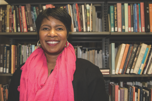 UI Associate Professor Katrina Sanders poses for a portrait in the Main Library on March 13. Sanders is working on the book The Rise and Fall of Black Catholic Education in a Changing South.