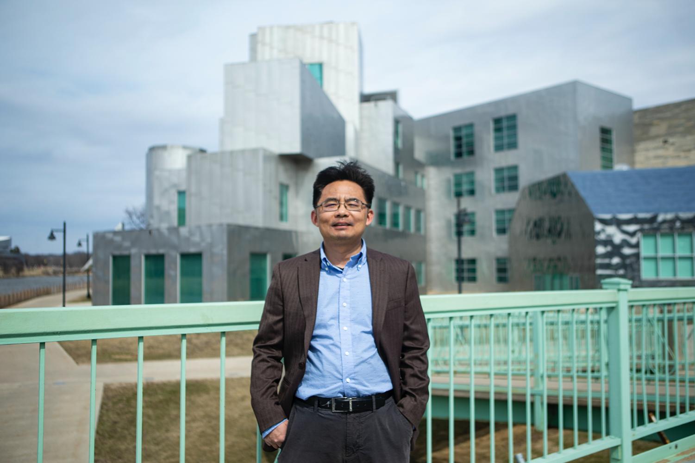 University of Iowa engineering professor Jun Wang stands outside the Iowa Advanced Technology Laboratories on March 27.