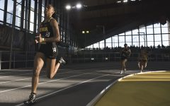 Iowa's Briana Guillory participates in the Women's 600m Run during the annual Black and Gold Intrasquad Meet at the UI Recreation Building on Saturday, Dec. 9, 2017. Guillory finished first with a time of 1:30:01. The Hawkeyes will host the next meet on January 13.