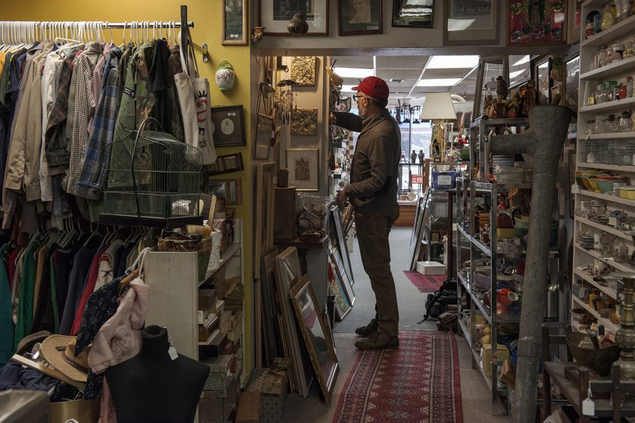 Artifacts+owner+Todd+Thelen+locates+an+item+for+a+customer+on+Thursday%2C+March+7%2C+2019.+Thelen+has+owned+Artifacts+for+16+years.+%28Nick+Rohlman%2FThe+Daily+Iowan%29