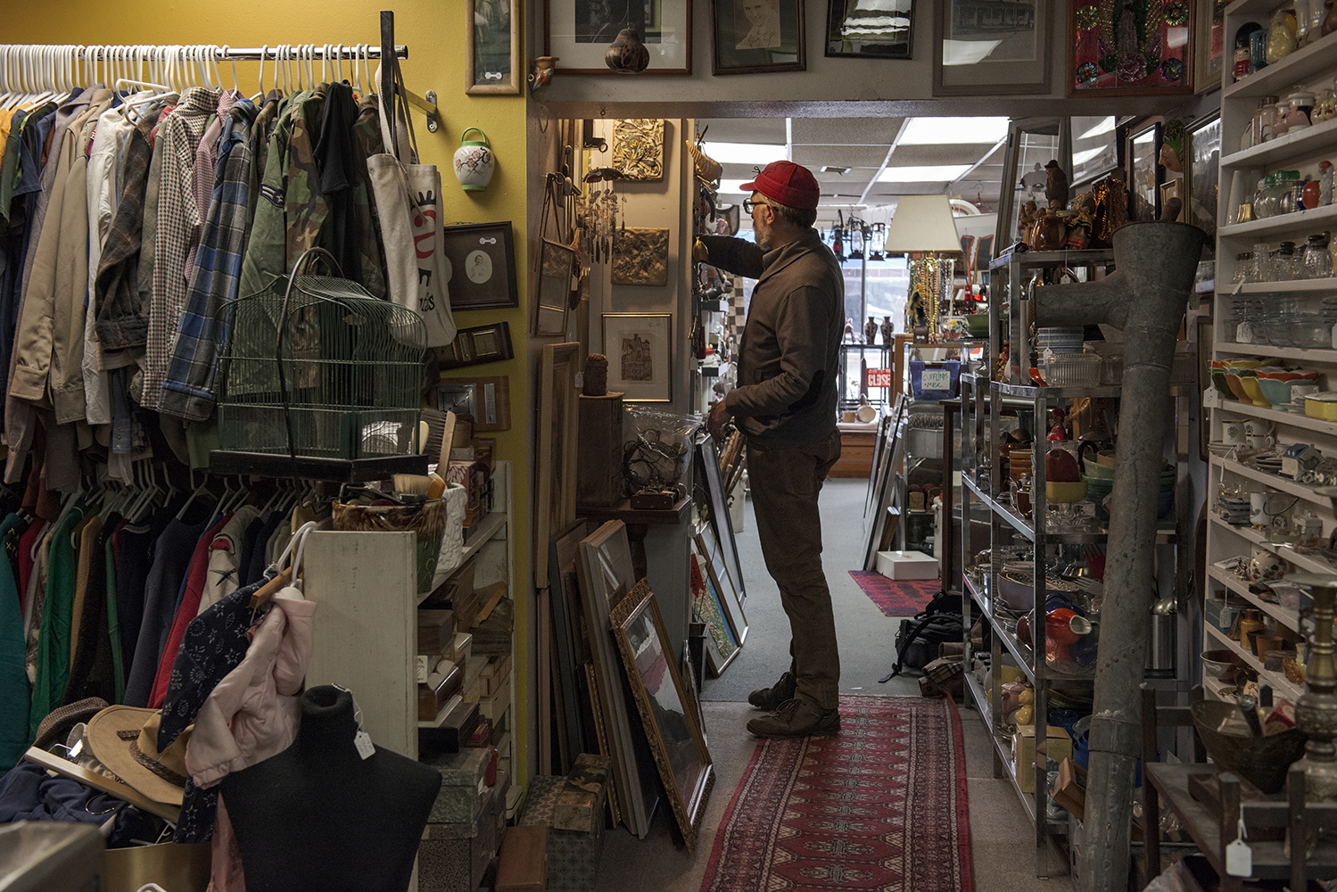 Artifacts owner Todd Thelen locates an item for a customer on Thursday, March 7, 2019. Thelen has owned Artifacts for 16 years. (Nick Rohlman/The Daily Iowan)