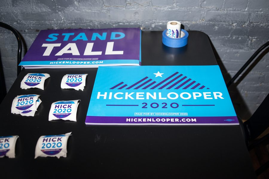 Campaign materials for former Colorado Governor John Hickenlooper sit on a tabe during a campaign stop at the 392 Caffé in Clinton, Iowa on Saturday, March 9, 2019.