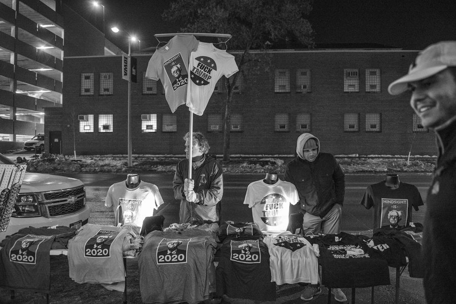 Vendors sell merchandise after a campaign rally for Sen. Bernie Sanders, I-Vt., at the Iowa Memorial Union on Friday, March 8, 2019. The rally was a part of Sen. Sanders first trip to Iowa since announcing his 2020 presidential bid.